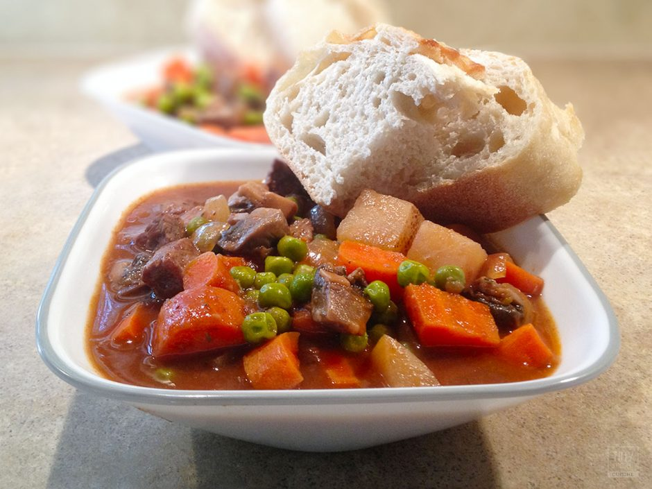 Classic beef stew with potatoes is an excellent cold weather comfort food. This easy beef stew recipe will warm your bones and fill your belly! | Tiny Kitchen Cuisine | http://tiny.kitchen
