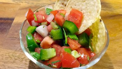 Pico De Gallo is a fresh mexican salsa. Spicy, fruity, and so easy to make, this recipe goes great with tortilla chips, quesadillas, or nachos. You can even put it on your tacos! | Tiny Kitchen Cuisine | https://tiny.kitchen