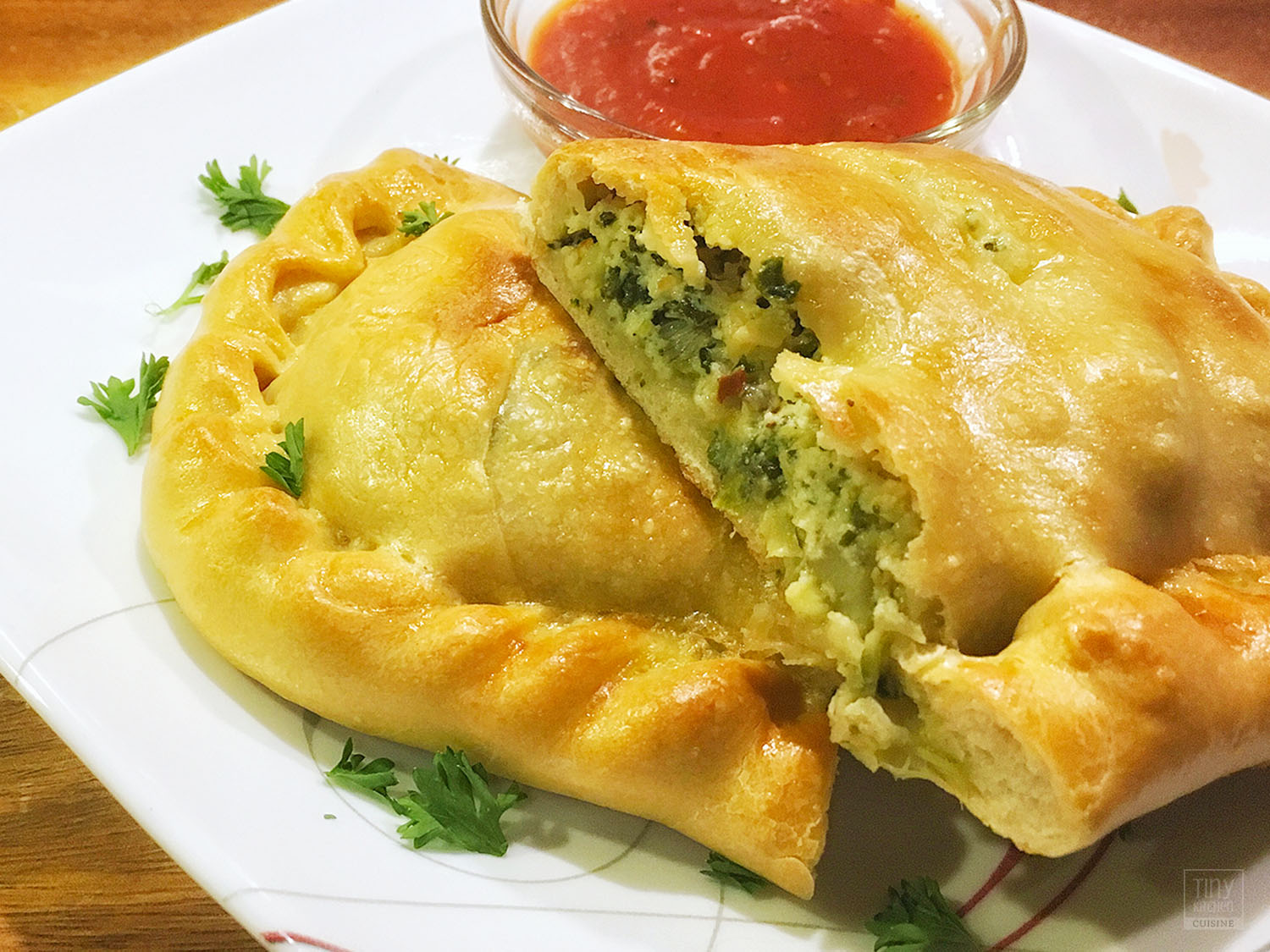 Cooking this Spinach Artichoke Calzone recipe from scratch in a tiny kitchen can be a labor of love but knowing how to make calzones is definitely worth it! | Tiny Kitchen Cuisine | http://tiny.kitchen