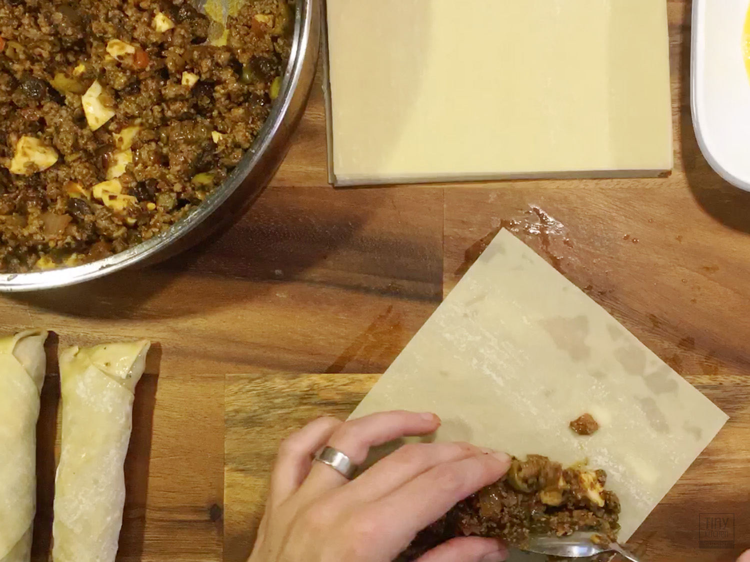 Wrapping the vegetarian fake beef and chorizo crumbles in egg roll wrappers is tedious, but can be easily frozen for a quick and tasty snack later on! | Tiny Kitchen Cuisine | https://tiny.kitchen/