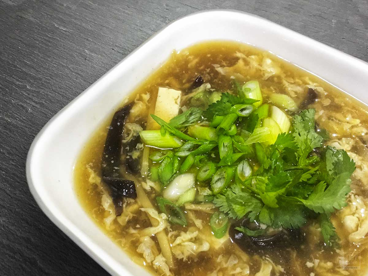 Ditch the takeout! This Hot and Soup soup is filled with varying textures and subtle flavors that add a whole new dimension to the classic Chinese-American soup. | https://tiny.kitchen/ | #chinese #soup #recipe