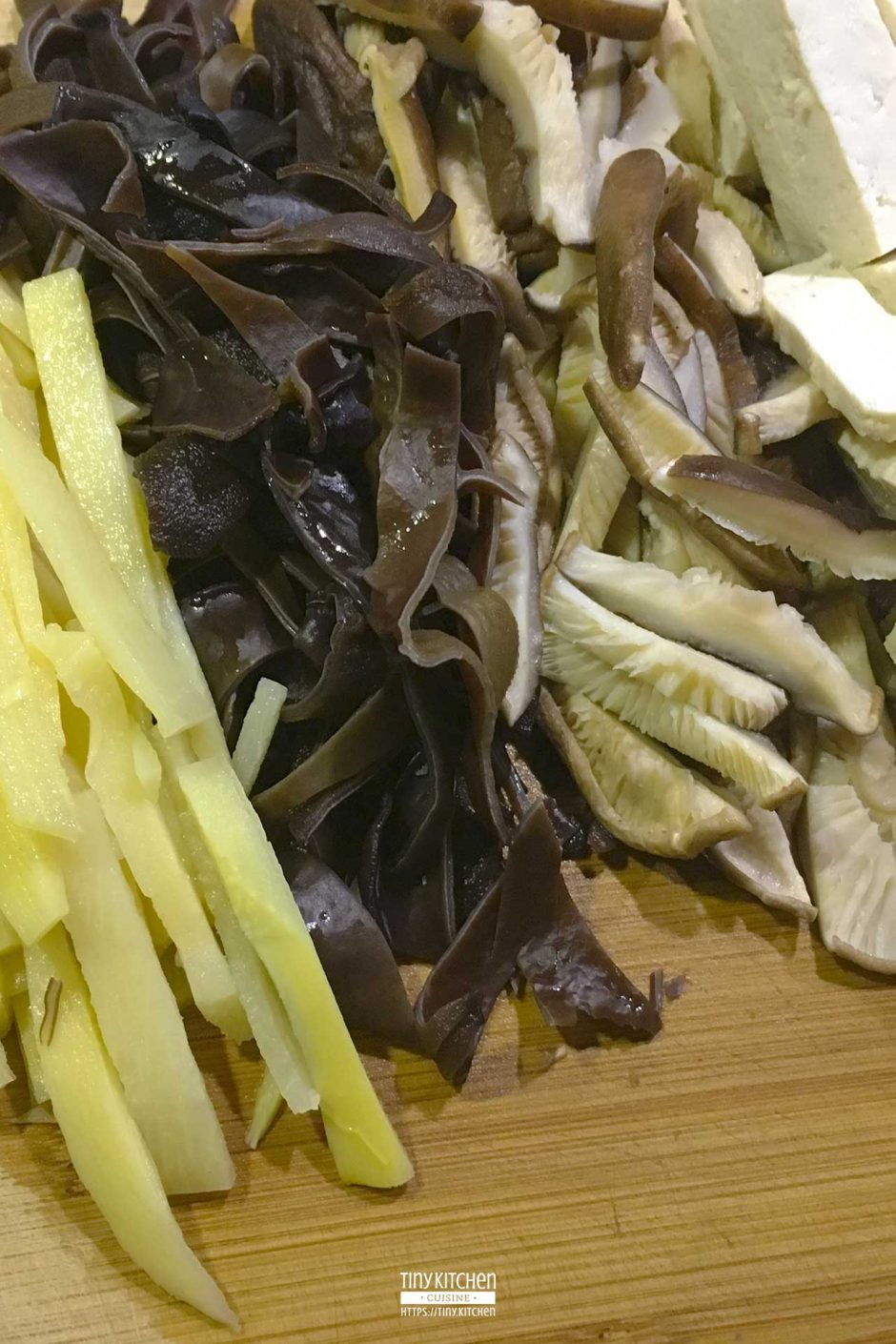 Bamboo shoots, wood ear mushrooms, shiitake mushrooms, and tofu sliced and prepared for Hot and Sour Soup.