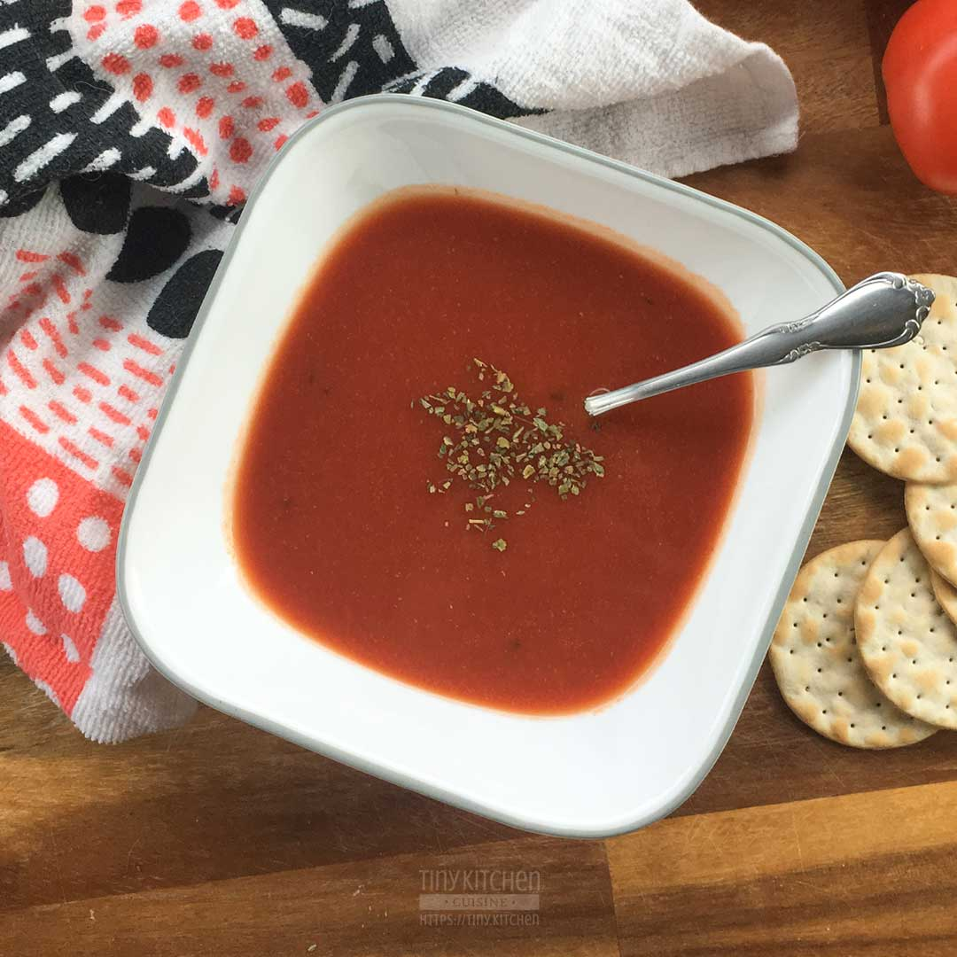 A bowl of tomato soup made with crackers.